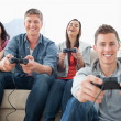 A laughing group enjoying the game together — Stock Photo