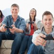 Stock Photo: Laughing group enjoying game together