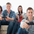 A happy group of friends playing games together while looking at — Stock Photo
