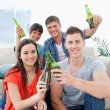 A celebrating group of friends with beers in hand — Stock Photo #13959155