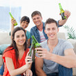 A celebrating group of friends with beers in hand — Stock Photo