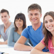 Side view of four students turned and looking towards the camera — Stock Photo #13959478