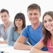 Side view of four students turned and looking towards the camera — Stock Photo