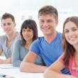 Side view of four students looking towards the camera — Stock Photo #13959498
