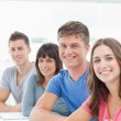 A brightly smiling group of looking into the camera — Stock Photo