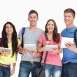 Stock Photo: Group of students with tablets and backpacks smiling and looki