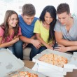 A group of friends about to eat pizza — Stock Photo