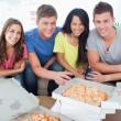 Friends sitting on a couch about to eat pizza — Stock Photo