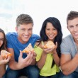 Friends about to eat their pizzas they look at camera — Stock Photo #13959719