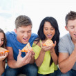 Friends eating pizza together — Stock Photo
