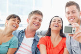 A laughing group pose for a funny photo — Stock Photo