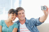 A smiling couple pose together for a photo — Stock Photo