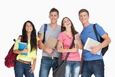 A laughing group of students as they look at the camera — Foto Stock