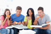 The friends tuck into the pizza just bought — Stock Photo