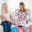 Girls trying out new clothes as they look at each other — Stock Photo #13962127