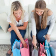 Girls looking into their shopping — Stock Photo