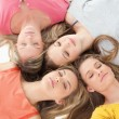 Four girls sleeping on the floor together — Stock Photo