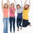 Smiling celebrating girls jumping up — Stock Photo