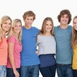 A group of friends smiling and holding each other — Stock Photo