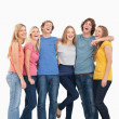 Full length of a group laughing together and looking at the came — Stock Photo #13962643