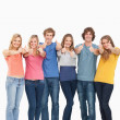 A group smiling and giving the thumbs up — Stock Photo #13962650