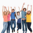 Celebrating friends jumping in the air — Stock Photo