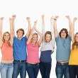Smiling raising hands up in the air — Stock Photo