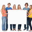 A group of holding blank sheet — Stock Photo #13962677