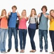 Smiling group giving thumbs up as they wear backpacks — Stockfoto #13962690