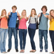 Stock Photo: Smiling group giving thumbs up as they wear backpacks