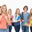A smiling girl stands in front of her college friends — Lizenzfreies Foto