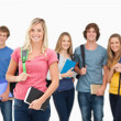 Smiling group stand together with one girl standing in front — Stock Photo