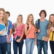 A girl standing in front of her college friends as they all smil — Stock Photo