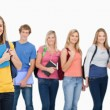 Royalty-Free Stock Photo: A group of college students standing as one girl stands in front