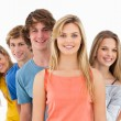 Stock Photo: Smiling group standing behind one another at various angles