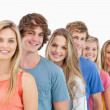 A smiling group standing behind each other — Stock Photo