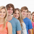 A smiling group standing behind each other at an angle — Stock Photo