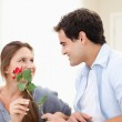 Man offering a rose to a Woman — Stock Photo