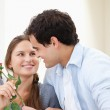 Man offering a rose to a Woman while embracing indoors — Stock Photo #13963374