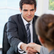Businessman shaking hands with a Businesswoman — Stock Photo #13963531