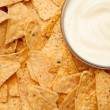 Nachos surrounding a bowl of white dip — Stock Photo