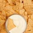 Chips surrounding a  bowl of dip — Stock Photo