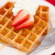 Waffles with whipped cream and strawberry on it — Stock Photo