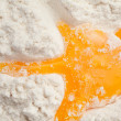 Egg yolk on the flour — Stock Photo