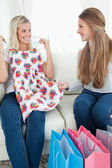 Girls looking at each other as they try out new clothes — Stock Photo