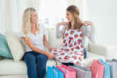 Girls trying out new clothes as they look at each other — Stock Photo