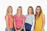 Four girls smiling as they look at the camera — Stock Photo
