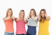 Girls sticking their thumbs up — Stock Photo