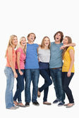 Full length of a group laughing together and looking at the came — Stock Photo