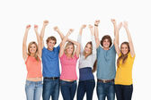A group of with their hands raised — Stock Photo
